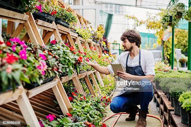 Gardener with digital tablet
