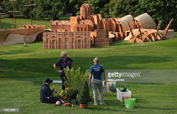 Gardeners tend to the area around the Equestrian Cross Country course at Greenwich Park on July 25, 2012 in London, England.