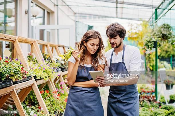 Gardeners with digital tablet