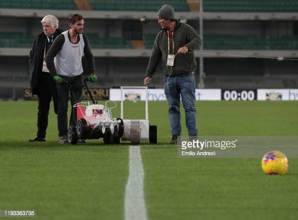 Gardeners work in the field prior to the Serie A match between Hellas Verona and Genoa CFC at Stadio Marcantonio Bentegodi on January 12 2020 in...