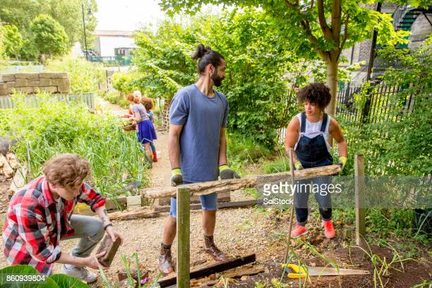 gardening at the farm - community stock photos and pictures
