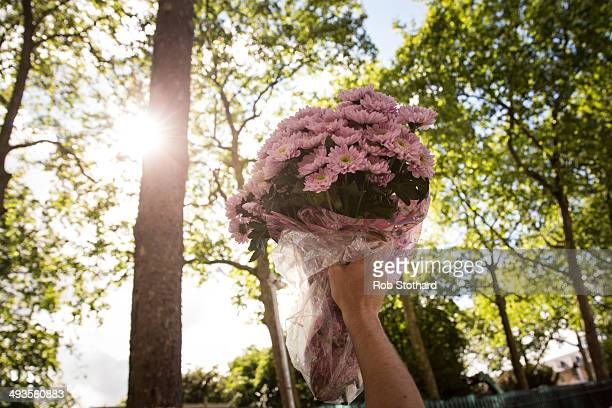 A gardening enthusiast carries flowers purchased on the final day of the Chelsea Flower Show at Royal Hospital Chelsea on May 24 2014 in London...