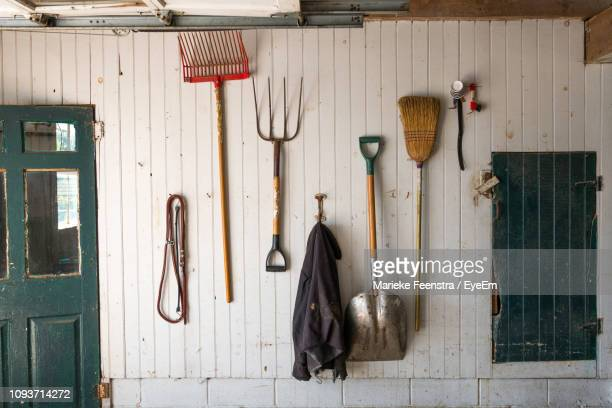 gardening equipment hanging on wall - shed stock pictures, royalty-free photos & images