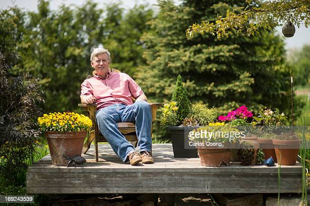 Gardening expert Mark Cullen poses for a photograph in the backyard of his home with some of his container plantings