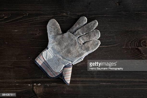 Gardening glove on wood, still life