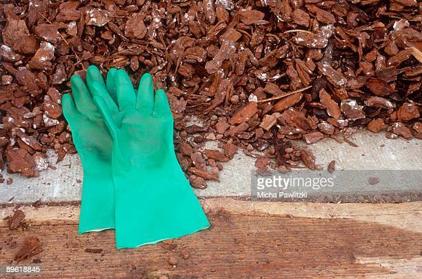 gardening gloves in mulch - mulch stock pictures, royalty-free photos & images