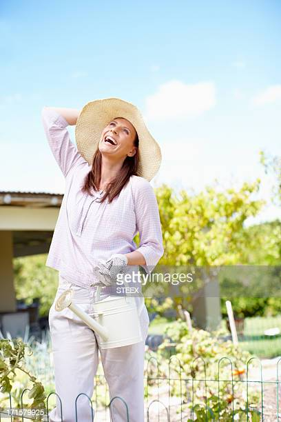 gardening is one of summer's true joys - one mature woman only stock pictures, royalty-free photos & images