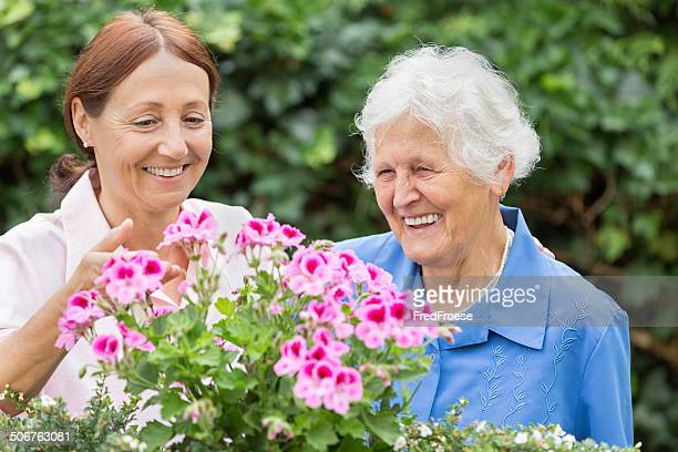 Gardening - senior woman with flowers