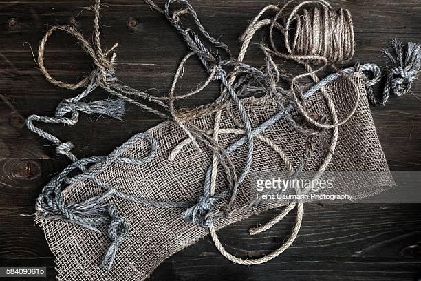 Gardening strings on wood, still life