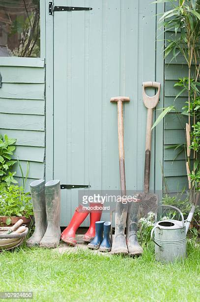 gardening tools at door of potting shed - streatham stock pictures, royalty-free photos & images