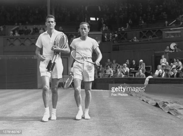 Gardnar Mulloy of the United States and Josip Palada of Yugoslavia walk on to Centre Court before their Men's Singles First Round match at the...
