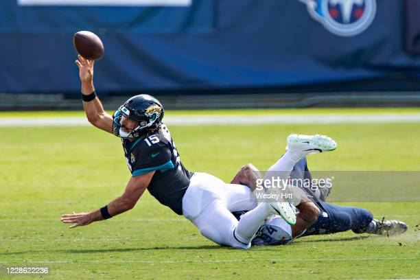Gardner Minshew II of the Jacksonville Jaguars is sacked in the first half of a game against the Tennessee Titans at Nissan Stadium on September 20,...