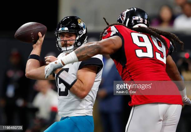 Gardner Minshew II of the Jacksonville Jaguars looks to pass as he is pressured by Adrian Clayborn of the Atlanta Falcons in the first half at...