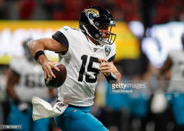 Gardner Minshew II of the Jacksonville Jaguars scrambles in the second half of an NFL game against the Atlanta Falcons at Mercedes-Benz Stadium on...