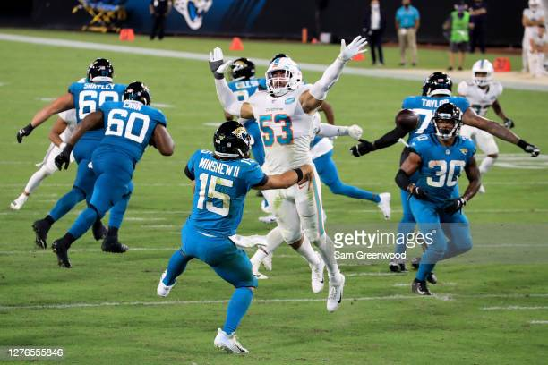 Gardner Minshew of the Jacksonville Jaguars is pressured by Kyle Van Noy of the Miami Dolphins during the game at TIAA Bank Field on September 24,...