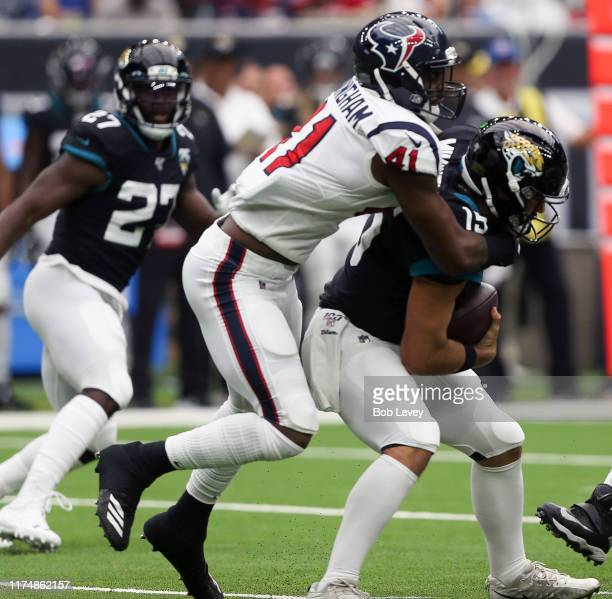 Gardner Minshew of the Jacksonville Jaguars is sacked by Zach Cunningham of the Houston Texans in the first quarter at NRG Stadium on September 15,...