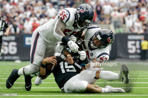 Gardner Minshew of the Jacksonville Jaguars is tackled by Benardrick McKinney of the Houston Texans and Brennan Scarlett in the second half at NRG...