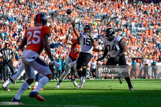 Gardner Minshew of the Jacksonville Jaguars passes after a long scramble for a third quarter touchdown against the Denver Broncos at Empower Field at...