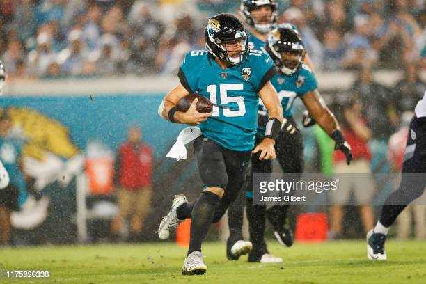 Gardner Minshew of the Jacksonville Jaguars runs for yardage during the third quarter of a game against the Tennessee Titans at TIAA Bank Field on...