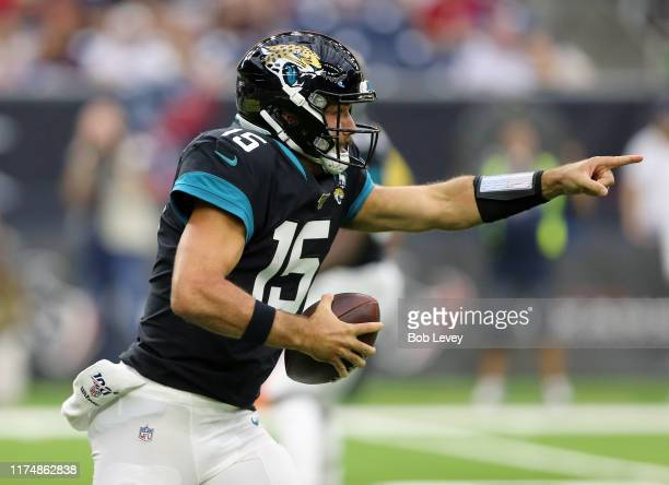 Gardner Minshew of the Jacksonville Jaguars scrambles out of the pocket during the first half against the Houston Texans at NRG Stadium on September...