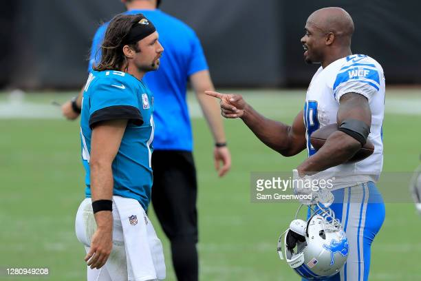 Gardner Minshew of the Jacksonville Jaguars talks with Adrian Peterson of the Detroit Lions after their game at TIAA Bank Field on October 18, 2020...