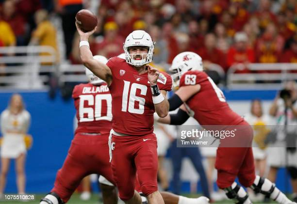 Gardner Minshew of the Washington State Cougars throws a pass in the first quarter against the Iowa State Cyclones during the Valero Alamo Bowl at...