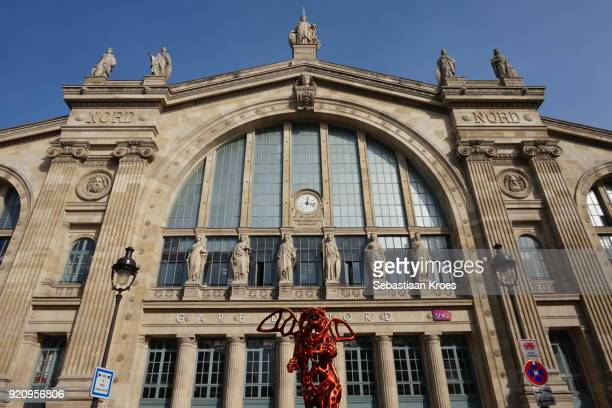 gare du nord and angel bear statue, paris, france - gare du nord stock pictures, royalty-free photos & images