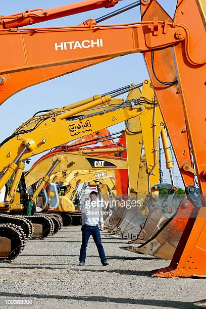 Gared Rank looks at hydraulic excavators made by Hitachi Ltd Liebherr Caterpillar Inc and Deere Co before a Ritchie Bros Auctioneers Inc industrial...