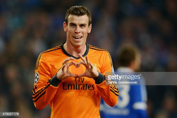 Gareht Bale of Real Madrid celebrates after scoring his team's second goal during the UEFA Champions League Round of 16 first leg match between...