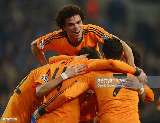 Gareht Bale of Real Madrid celebrates with team mates after scoring his team's second goal during the UEFA Champions League Round of 16 first leg...