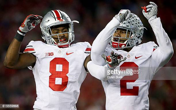 Gareon Conley and Marshon Lattimore of the Ohio State Buckeyes celebrate after Conley made an interception in the third quarter against the Wisconsin...