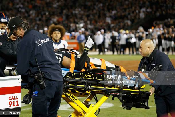 Gareon Conley of the Oakland Raiders gives a thumbs up while being stretchered from the field in the third quarter against the Denver Broncos at...