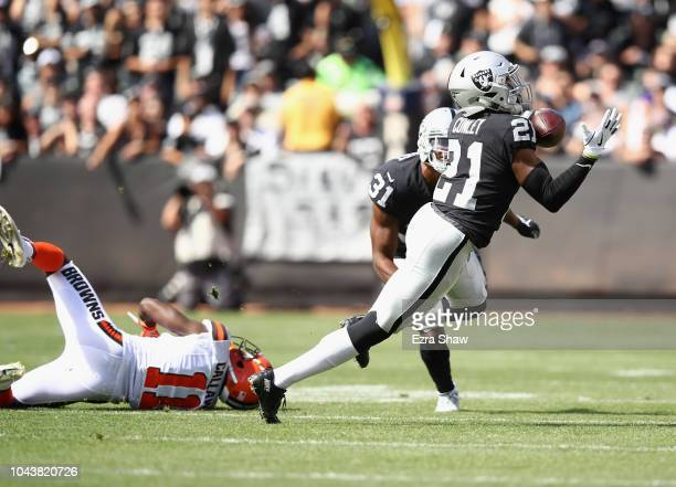 Gareon Conley of the Oakland Raiders intercepts a pass intended for Antonio Callaway of the Cleveland Browns and runs in back for a touchown at...