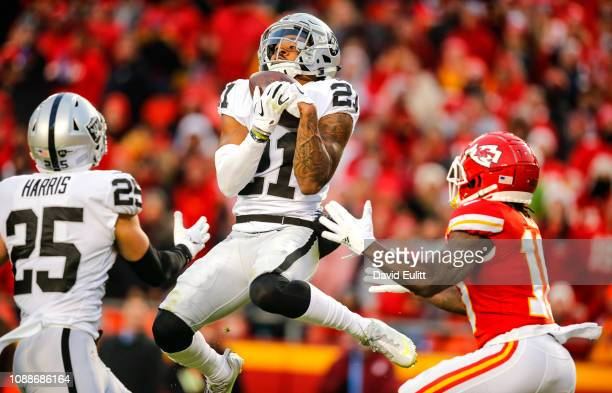 Gareon Conley of the Oakland Raiders intercepts a pass intended for Tyreek Hill of the Kansas City Chiefs in the second quarter at Arrowhead Stadium...