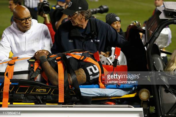 Gareon Conley of the Oakland Raiders is stretchered from the field in the third quarter against the Denver Broncos at RingCentral Coliseum on...
