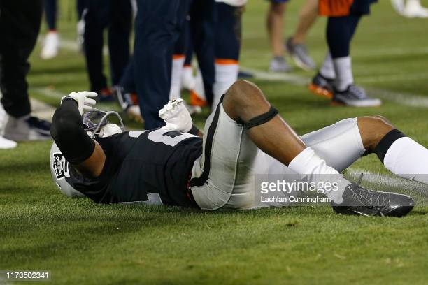 Gareon Conley of the Oakland Raiders lays injured on the ground after a play in the third quarter of the game against the Denver Broncos at...