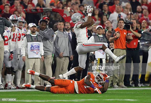 Gareon Conley of the Ohio State Buckeyes intercepts a pass intended for Mike Williams of the Clemson Tigers during the first half of the 2016...