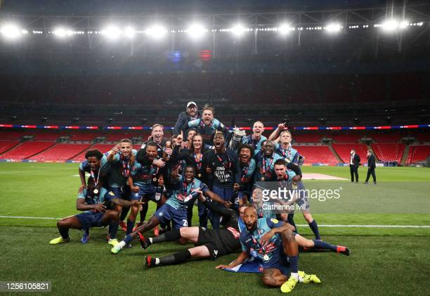 Gareth Ainsworth manager of Wycombe Wanderers celebrates with his team and the trophy after winning the Sky Bet League One Play Off Final between...