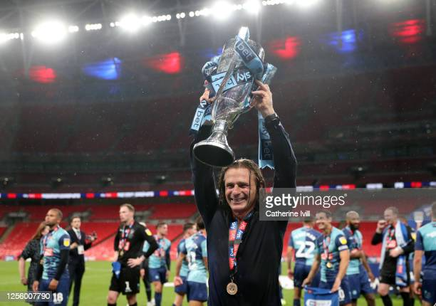 Gareth Ainsworth manager of Wycombe Wanderers celebrates with the trophy after the Sky Bet League One Play Off Final between Oxford United and...