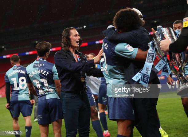 Gareth Ainsworth manager of Wycombe Wanderers walks amongst his team as the celebrate winning the Sky Bet League One Play Off Final between Oxford...