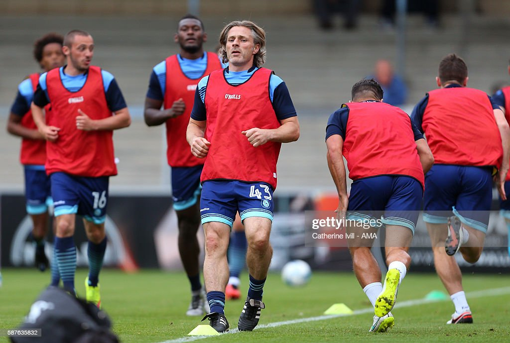 Gareth Ainsworth manager of Wycombe Wanderers warms up with the team having named himself on the bench ahead of the EFL Cup match between Wycombe Wanderers and Bristol City at Adams Park on August 8, 2016 in High Wycombe, England.