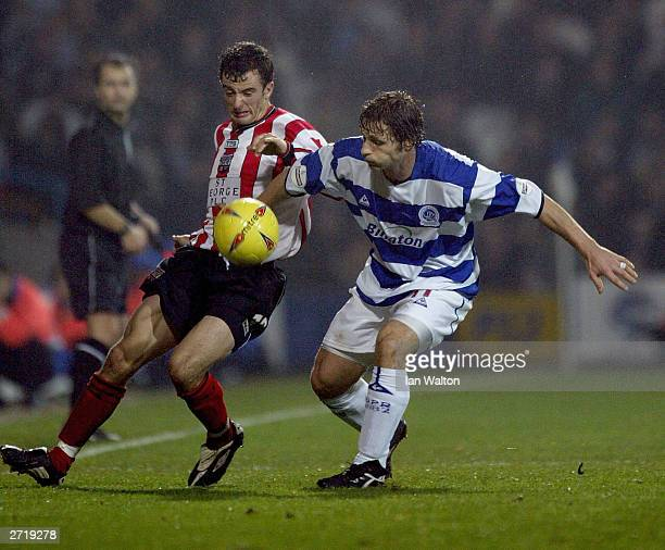 Gareth Ainsworth of QPR tries to tackle Stephen Hunt of Brentford during the Nationwide Football League Division two match between Queens Park...