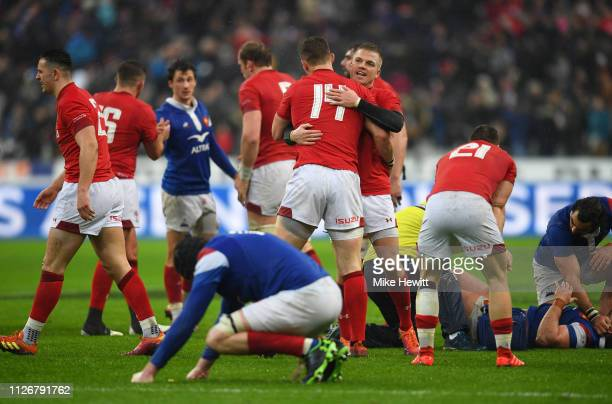 Gareth Anscombe and George North of Wales celebrate victory after the Guinness Six Nations match between France and Wales at Stade de France on...