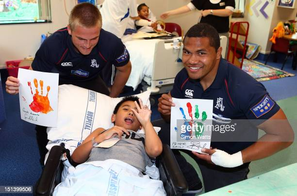 Gareth Anscombe and Peter Saili pose for a picture during an Auckland ITM Cup rugby player visit to the Auckland Kidz First Children's Hospital on...