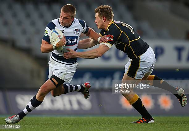 Gareth Anscombe of Auckland is tackled by Jason Woodward of Wellington during the round nine ITM Cup match between Auckland and Wellington at Eden...