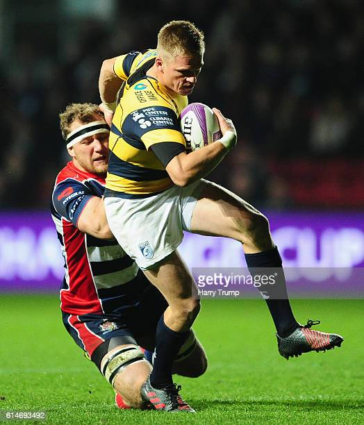 Gareth Anscombe of Cardiff Blues is tackled by Nick Koster of Bristol Rugby during the European Rugby Challenge Cup between Bristol Rugby and Cardiff...