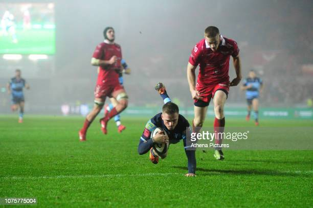 Gareth Anscombe of Cardiff Blues scores his side's fourth try during the Guinness Pro14 round 12 match between the Scarlets and Cardiff Blues at the...