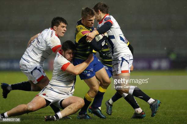 Gareth Anscombe of Cardiff Bluesis tackled by Cameron Neild AJ MacGinty and Ben Curry of Sale Sharks and during The European Rugby Challenge Cup...