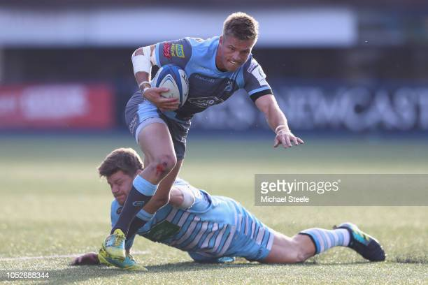 Gareth Anscombe of Cardiff evades the challenge of Oli Kebble of Glasgow during the Champions Cup Pool 3 match between Cardiff Blues and Glasgow...