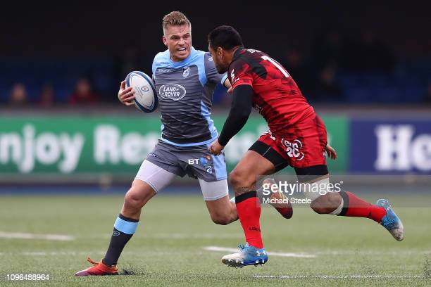 Gareth Anscombe of Cardiff holds off Rudi Wulf of Lyon during the Champions Cup Pool 3 match between Cardiff Blues and Lyon Olympique Universitaire...